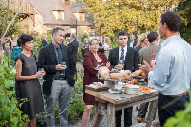 Attendees talk in dooryard garden during 10th anniversary gala