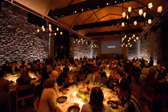 Attendees sit in hayloft during 10th anniversary gala