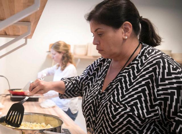 Ana Plana, Teacher Institute attendee, in kitchen