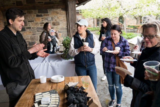 Blue Hill staff discussing cheese with visitors